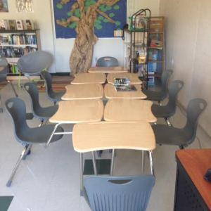 I create a makeshift table in the back of the room for our small-group discussions.